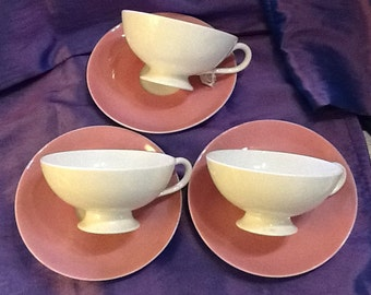 Set of three bone china coffee cups and saucers