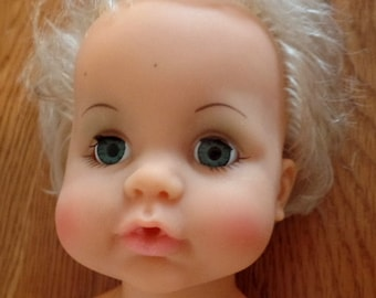 Blonde baby doll, with blue fixed eyes.  She is dated 1972 (I think), Ideal Toys.