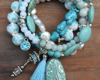 Turquoise colored set of stackable stretch to fit bracelets with freshwater pearls and charms