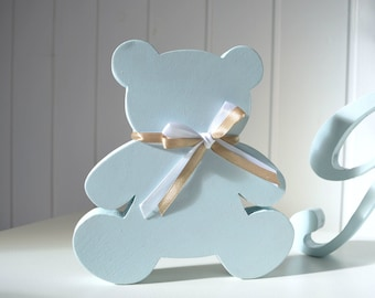 Wooden teddy bear with bow