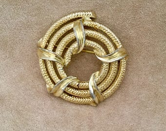 BSK Signed Goldtone Circle Brooch Pin