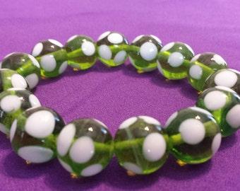 Bracelet: Very Fun Stretch Bracelet Green Beads with White Polkadots