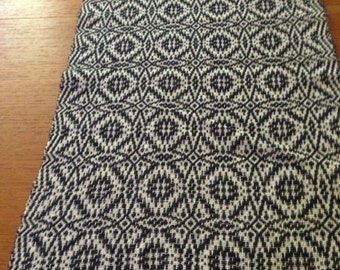 Handwoven table runner with navy overshot pattern