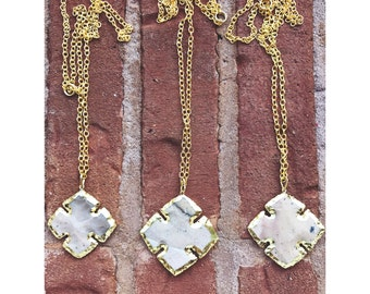 Gold edged cross necklace