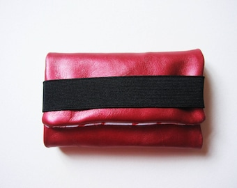 pouch has pink iridescent and cotton upcycled leather