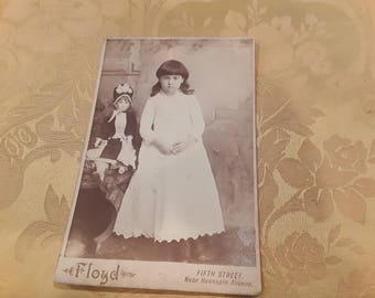 Minnesota Union card photograph of lucky young girl with Jumeau French Bebe doll, circa 1880 by Floyd's Studio, Minneapolis.