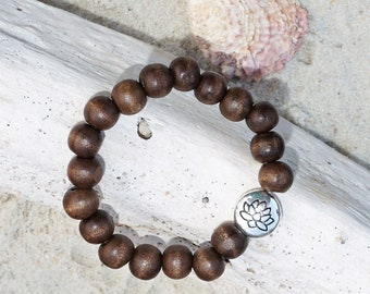 I Rise in Adversity   Wood beads, silver plated lotus charm