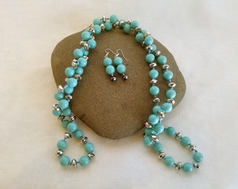 Turquoise and silver beaded necklace and earring set
