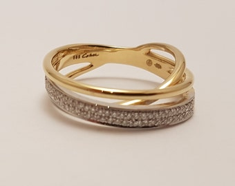 Bi-color white gold and gold ring. Diamonds in gold ring. Unique artful ring by Cober.