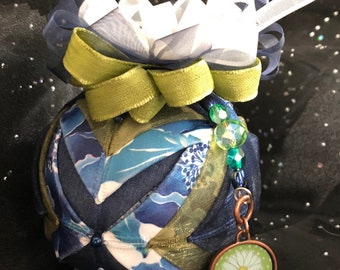 "3"" Handcrafted Ornament made with Floral Fabric and Ribbon."