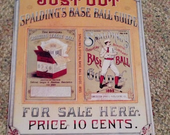 1993 just out spalding's base ball guide tin sign