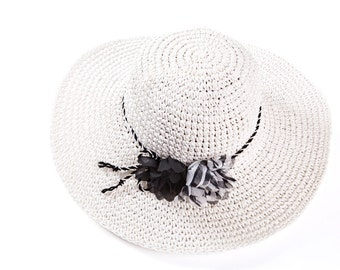 Straw hat , Sun hat , Black and white hat , decorated with a pair of flowers.