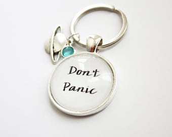 The Hitchhiker's Guide to the Galaxy quote keyring. Arthur Dent. Don't Panic. Vogon. Towel. All the Fish. Douglas Adams