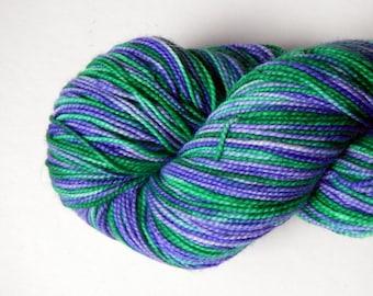 Hand dyed lavender and green 100% merino superwash sock yarn