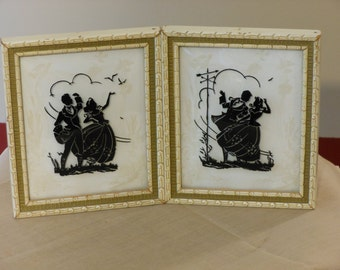 A Pair of Small Silhouettes of Man and Woman on a Windy Day