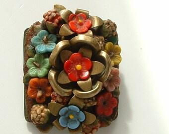 Vintage metal and glass flower brooch