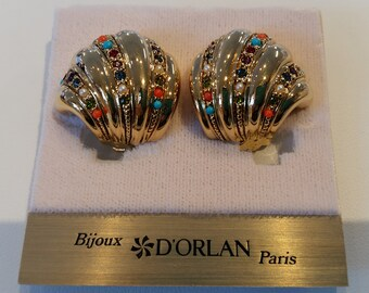D'Orlan Buried Treasure Clip Earrings.  Triple 22kt gold with handset Swarovski crystals.  SIGNED, New, Carded