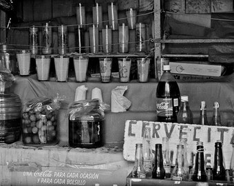 One Bottle of Coke in a San Cristobal Tienda- a black and white photograph