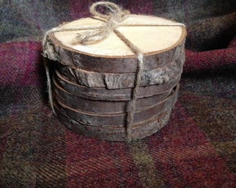 Six rustic birch coasters with bark