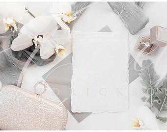 Gray, gold, white deckled edge stationery mockup for wedding with ring and orchids