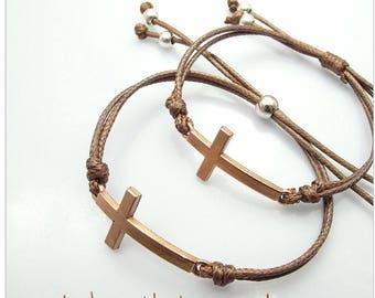 Cross adjustable cord bracelet