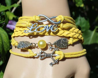 1 BRACELET CHARM, LOVE, ANCHOR, OWL, YELLOW PLUS AN EXTENSION CHAIN AND CLASP.