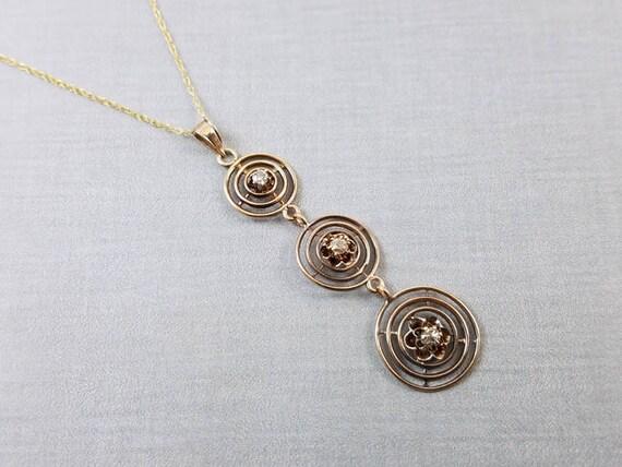 Antique Art Deco 10K gold three diamond journey long drop lavalier pendant necklace