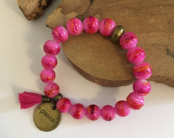 Bracelet matched drawn pink glass beads, tassel and pampillle