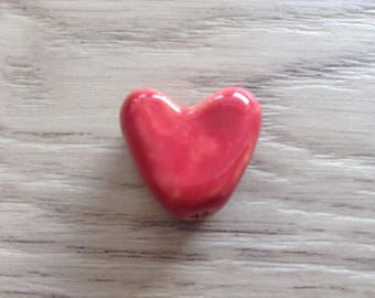 Red hand shaped ceramic bead