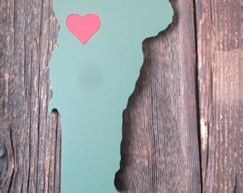 State heart wall decor.  Painted wooden cutouts.