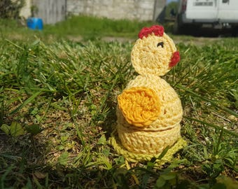 egg cosy and egg (egg cosy) in the shape of yellow chick covers