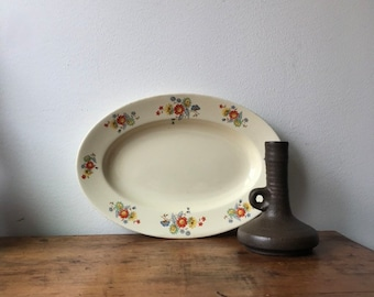 Large serving platter with multicolored floral pattern by Societe Ceramique Maestricht