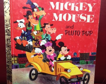 Mickey Mouse and Pluto Pup.  A Little Golden Book
