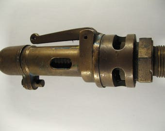A nice old Steam safety pressure relief valve. Marked set 105 Lbs for Steam / train / traction engine.