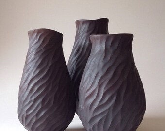 Carved porcelain vase in dark chocolate brown glaze