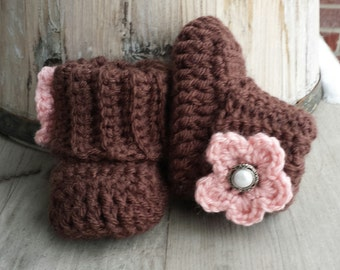 Crochet baby girl boots, in chocolate brown and pink flower and pearl button center. size 0 to 3 mo.