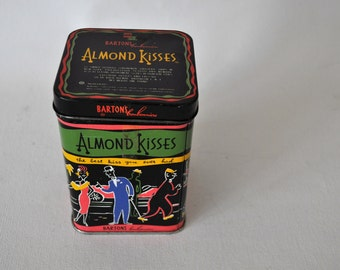 Vintage Barton's Bonbonniere Almond Kisses Tin. 1950's Brooklyn, NY. Retro Tin. Black background with hip cool graphics. Collectible!