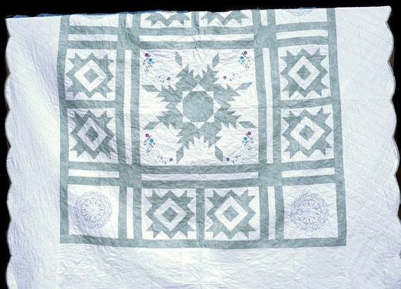 Quilt Vintage Inspired Handcrafted Queen Size with delicate embroidered elements.  Adds a Perfect Vintage Flare to any bnb or Cottage.