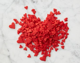 Red heart sprinkles, large and small, perfect for Valentine's Day cakes and cupcakes