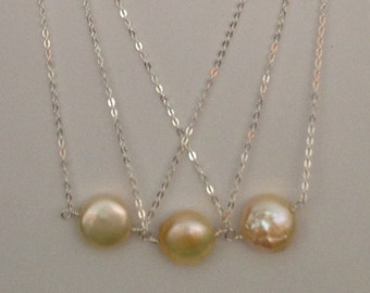 16.5 inch 10 to 11mm peach coin pearl station wire wrap sterling silver necklace