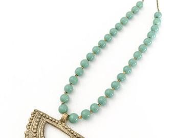 The Beaded Boho - Brass engraved tibetan pendant necklace.