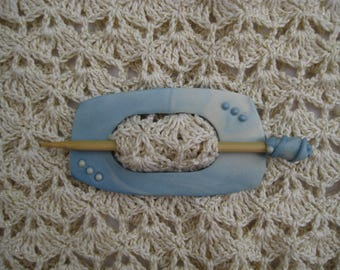 Handmade polymer clay shawl pin in blue and pearl colours.