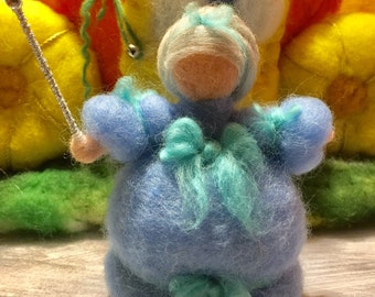 This is Cinderella's fairy godmother in carded, fairy wool.In style Waldorf.