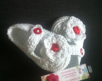 a pair of 100% cotton crochet baby shoes