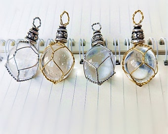 White crystal ball quartz necklace pendant hand wire mesh weaving pattern.