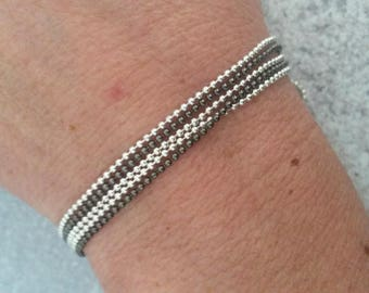 Assortment of chain bracelet silver and black beads