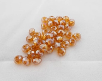 2 orange Crystal beads 4 x 6 mm faceted. (9076160)