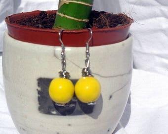 Steel earrings and lemon yellow ceramic