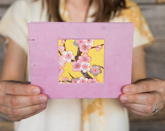 Handmade book with pink cherry blossoms
