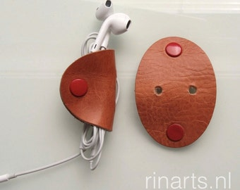 Earbuds holder / earphone / headphone cable organizers in tan vegetable tanned bridle leather. Set of 2